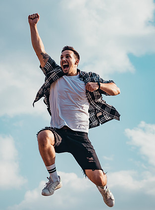 man jumping in air with happiness