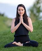 woman sitting in meditation posture